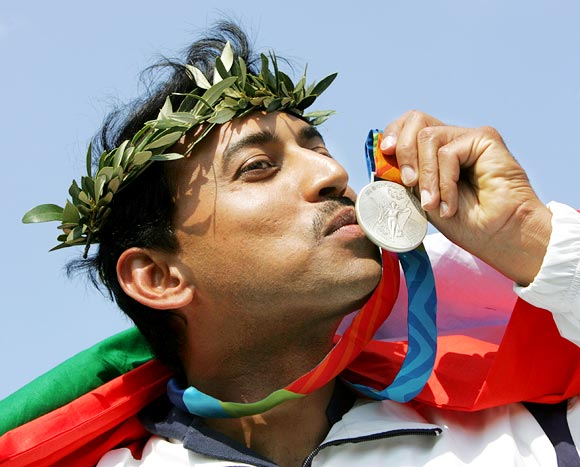 Rajyavardhan Singh Rathore kisses the silver medal he won at the Athens Olympics in 2004