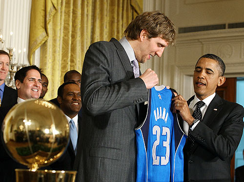 President Barack Obama (right) is given a jersey from Dirk Nowitzki of the Dallas Mavericks