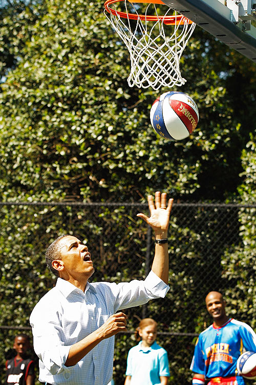 US President Barack Obama shoots a basketball