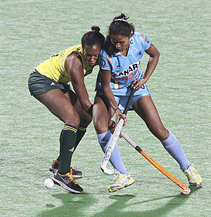 South Africa's George fights for the ball with Asunta Lakra
