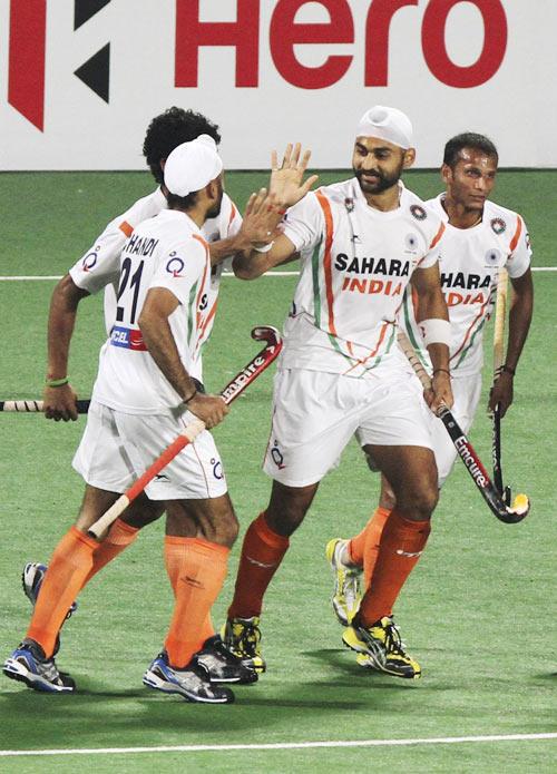 Sandeep Singh (centre) celebrates