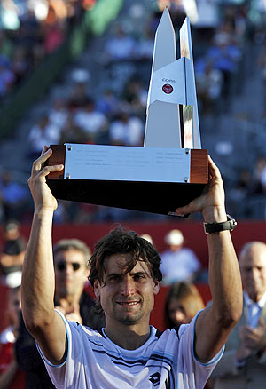 David Ferrer lifts up the trophy after defeating compatriot Nicolas Almagro in their men's singles final at the ATP Buenos Aires Open on Sunday