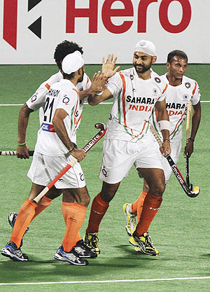 India's Sandeep Singh celebrates with teammates after scoring on Sunday