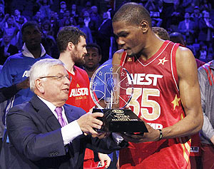 NBA commissioner David Stern presents the MVP trophy to West All-Star Kevin Durant of the Oklahoma City Thunder after the NBA All-Star game in Orlando, Florida, on Sunday
