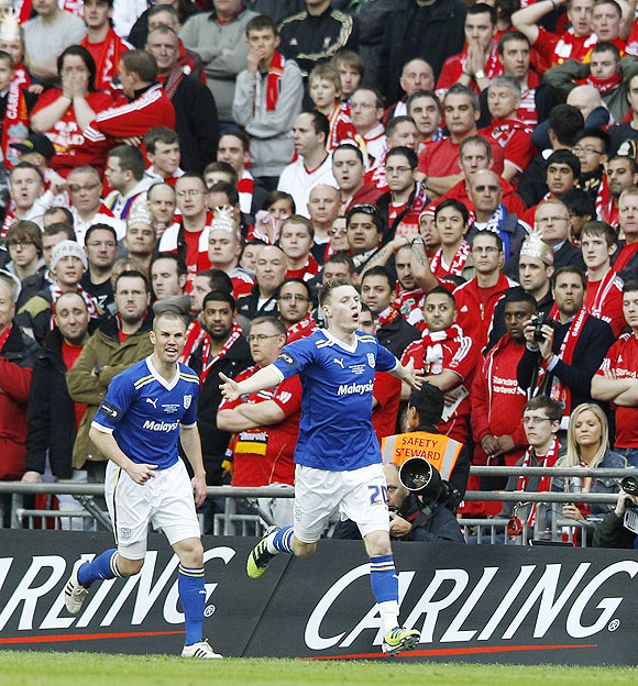 Cardiff City's Joe Mason (right) celebrates after scoring against Liverpool