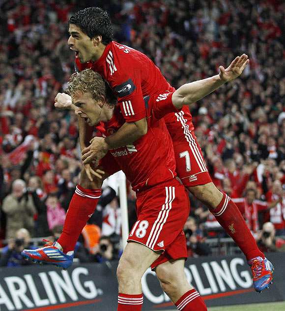 Liverpool's Dirk Kuyt (left) celebrates with Luis Suarez after scoring in extra time
