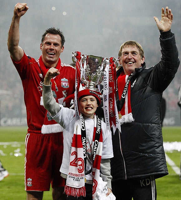 Liverpool's Jamie Carragher (left), his son James and coach Kenny Dalglish (right) celebrate after winning the final