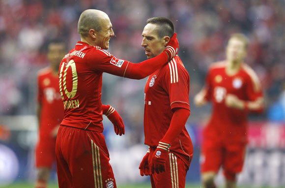 Franck Ribery of Bayern Munich celebrates his second goal against FC Schalke 04 with team mate Arjen Robben (L) during their German first division Bundesliga soccer match in Munich