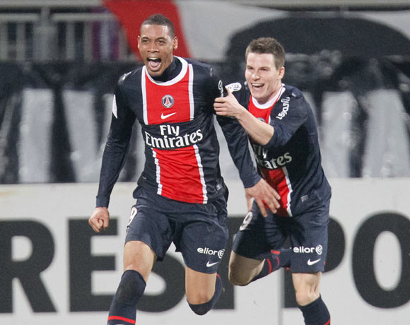 Guillaume Hoarau (L) and Kevin Gameiro of Paris St-Germain celebrate after scoring against Olympique Lyon during their French Ligue 1 soccer match at the Gerland stadium in Lyon