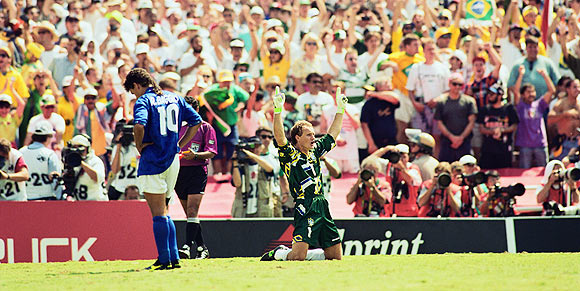 Goalkeeper Taffarel of Brazil celebrates after Roberto Baggio of Italy misses his penalty