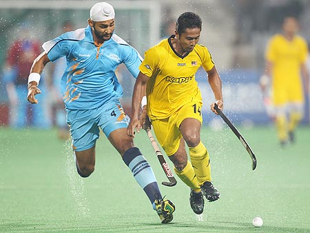 India's Sandeep Singh, left, in action