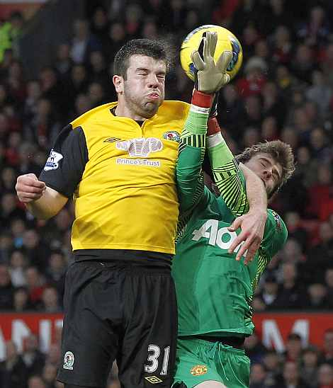 Blackburn Rovers' Grant Hanley beats Manchester United's David de Gea to score