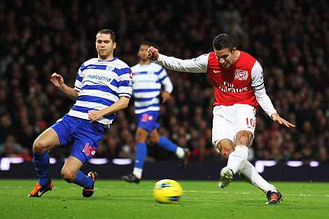 Arsenal's Robin van Persie scores against QPR