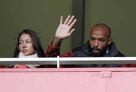 Thierry Henry watches the English Premier League match between Arsenal and Queens Park Rangers in London