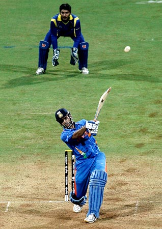 India Captain Mahendra Singh Dhoni hits a six to win the 2011 World Cup for India in Mumbai in April last year