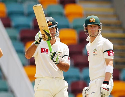 Ricky Ponting asks for the Decision Revision System as his partner Michael Clarke, right, looks on