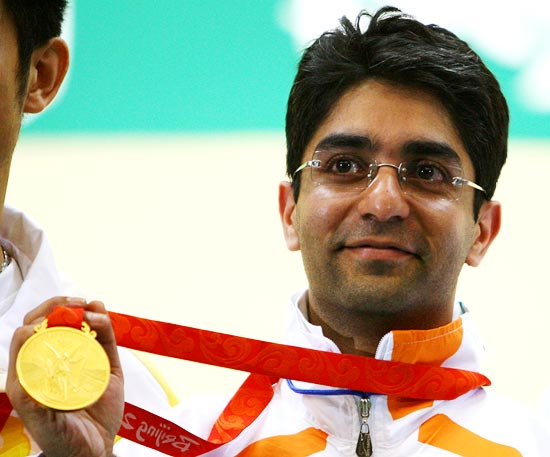 Abhinav Bindra poses with the gold medal he won in the men's 10m air rifle at the 2008 Beijing Olympics