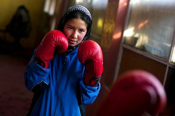 An Afghan woman practises inside a boxing club in Kabul