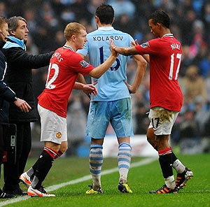 Paul Scholes of Manchester United comes on as a substitute during the FA Cup Third Round match against Manchester City on  Sunday