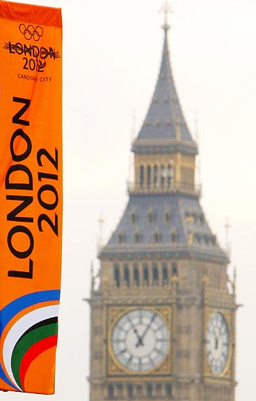 A London 2012 Olympic Games banner flutters in the wind with Big Ben in the background