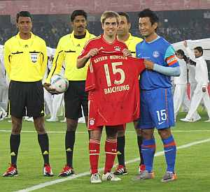 Bayern captain Phillip Lahm presents Bhutia his team's jersey before the start of the match