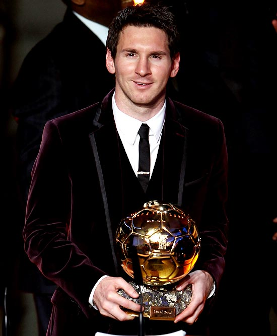 Lionel Messi receives the FIFA Ballon d'Or 2011 trophy
