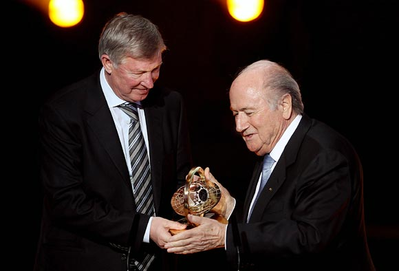Manchester United coach Alex Ferguson receives the FIFA Presidential Award 2011 from FIFA president Sepp Blatter