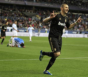Real Madrid's Karin Benzema celebrates after scoring against Malaga during their Spanish Kings Cup match