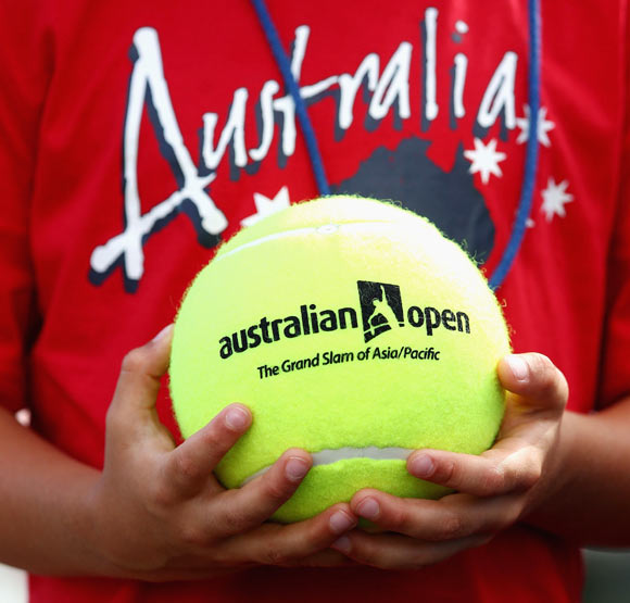 A fan holds an Australian Open Ball