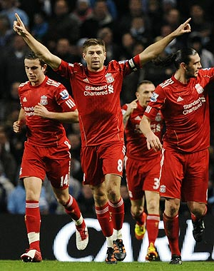 Liverpool's Steven Gerrard (2nd from left) celebrates his goal against Manchester City during their English League Cup semi-final on Wednesday