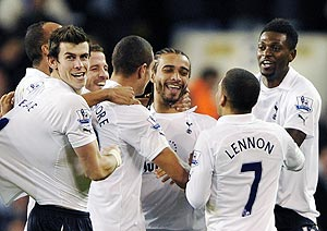 Tottenham Hotspur's players celebrate with Benoit Assou-Ekotto (centre) after he scored the winner against Everton on Wednesday