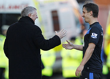 Gary Neville with Alex Ferguson