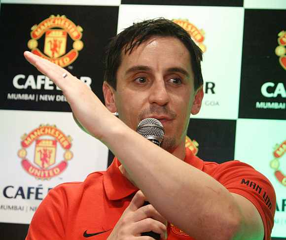 Former Manchester United captain Gary Neville is cheered by the crowd at the Manchester United Cafe in Mumbai on Thursday