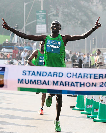 Kenya's Laban Moiben crosses the finish line at the Mumbai Marathon on Sunday