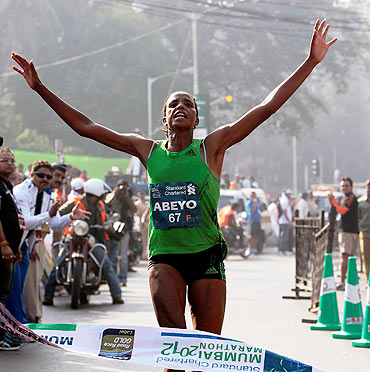 A jubilant Netsanet Abeyo of Ethiopian on crossing the finish line