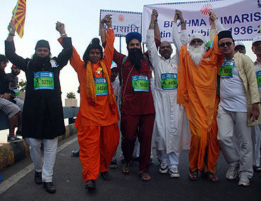 Participants take the unity in diversity theme on to the roads during the Mumbai Marathon on Sunday