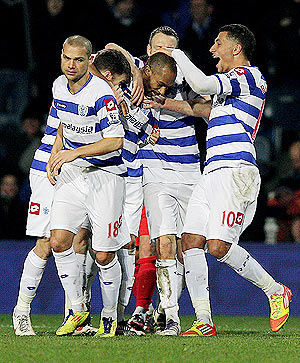 QPR's Danny Gabbidon (centre) is congratulated by teammates after scoring the opening goal against MK Dons during their FA Cup match on Tuesday