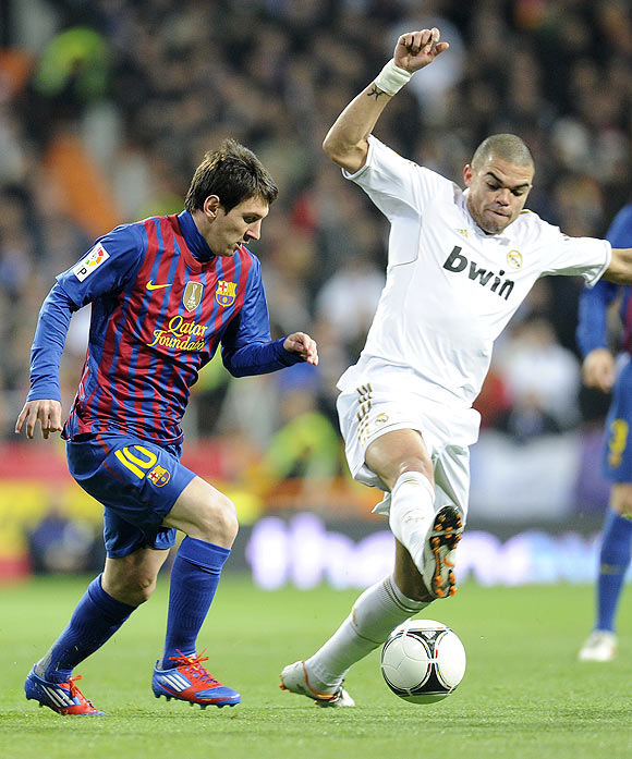 Real Madrid's Pepe (right) challenges Barcelona's Lionel Messi during their King's Cup quarter-final first leg tie on Wednesday