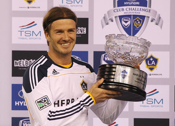 David Beckham of the Galaxy poses with the man of the match trophy during the friendly match between the Melbourne Victory and LA Galaxy at Etihad Stadium