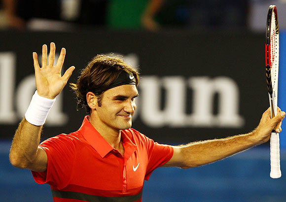 Federer ends Tomic's dream run