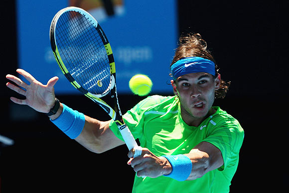 Nadal keeps fingers crossed after reaching quarters
