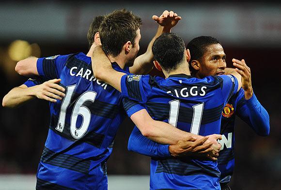 Antonio Valencia of Manchester United (right) celebrates with team-mates