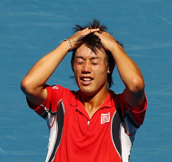Kei Nishikori of Japan celebrates winning his fourth round match against Jo-Wilfried Tsonga of France