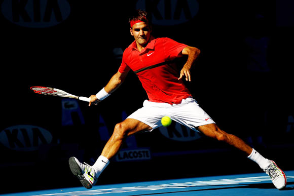 Roger Federer of Switzerland plays a backhand in his quarter final match against Juan Martin Del Potro of Argentina during day nine of the 2012 Australian Open
