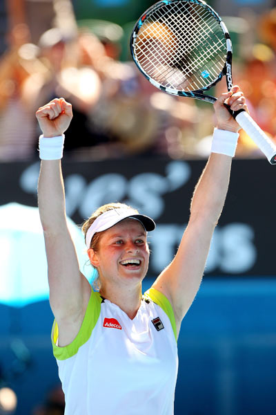 Kim Clijsters of Belgium celebrates winning her quarter final match against Caroline Wozniacki of Denmark during day nine of the 2012 Australian Open at Melbourne Park