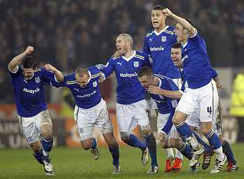 Cardiff City players rejoice after winning the match