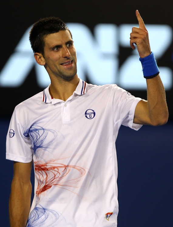 Novak Djokovic of Serbia calls for a challenge in between games in his quarter final match against David Ferrer of Spain