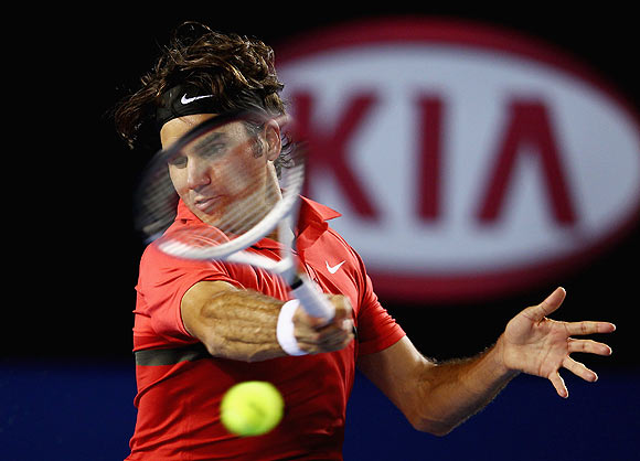 Roger Federer of Switzerland plays a forehand in his semifinal match against Rafael Nadal of Spain
