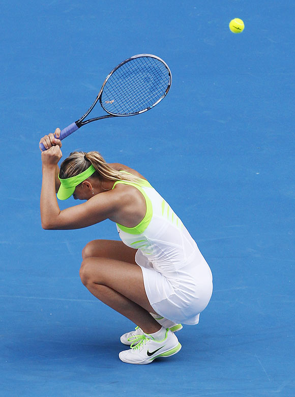 Maria Sharapova celebrates after defeating Petra Kvitova in their women's singles semi-final on Thursday