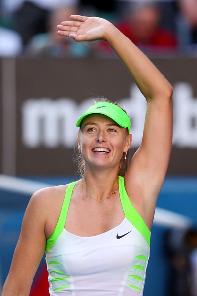 Maria Sharapova of Russia celebrates winning match point in her semifinal match against Petra Kvitova of the Czech Republic